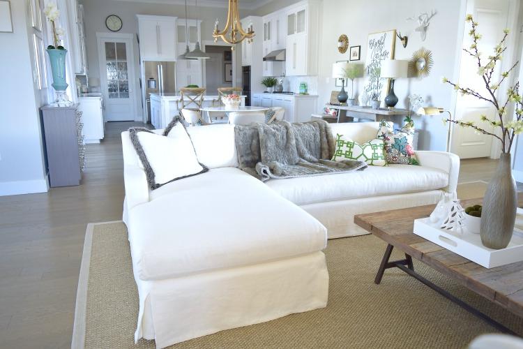 Nuetral living room restoration hardware couch white kitchen