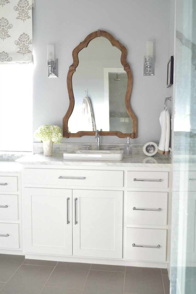 White-marble-bathroom-wooden-mirror