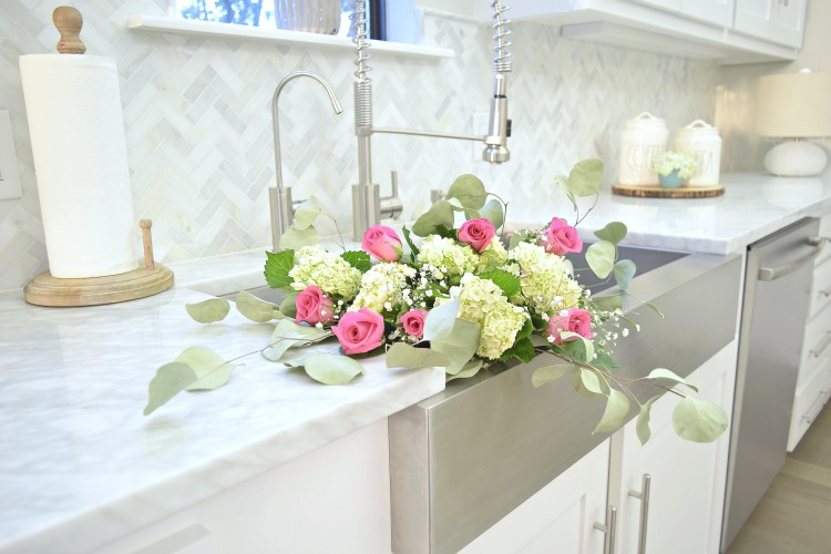 flowers in the sink hydrangeas pink roses