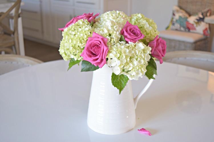 pink roses baby white hydrangeas boquet white pitcher