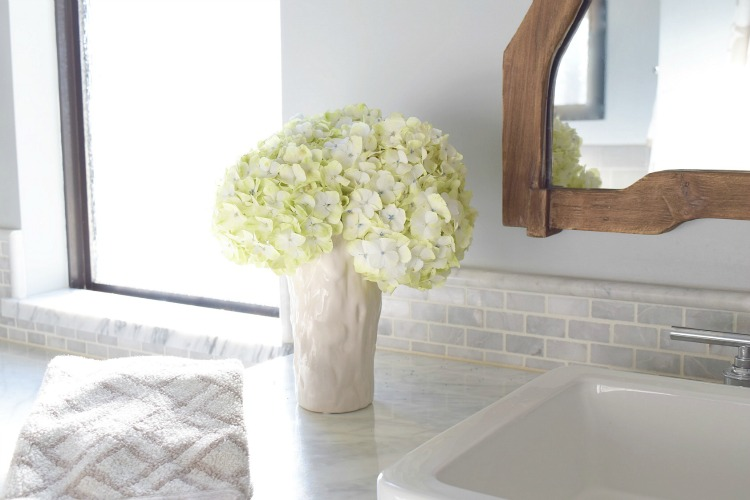 white hydrangeas carrara marble master bath