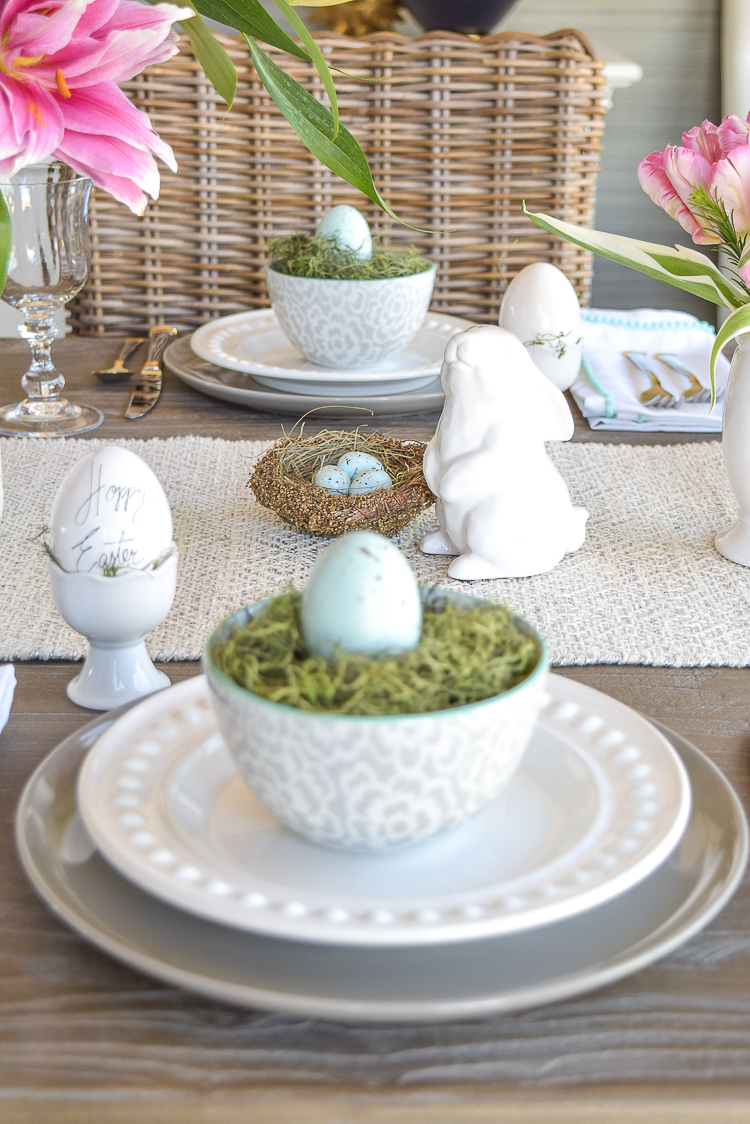 Easter table bunnies dishes flowers tablescape