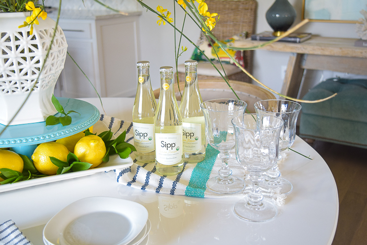 White vase spring summer dishes aqua cake stand forsythia yellow flower bush brunch lemons table scape center piece_-10