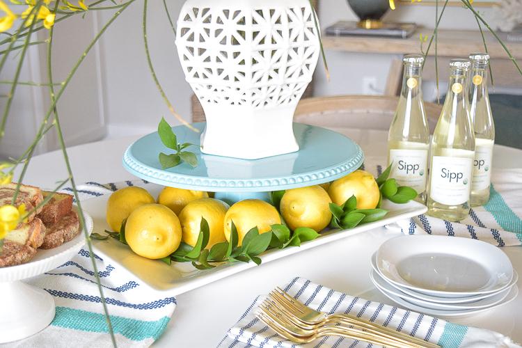 aqua cake stand lemons table scape spring brunch