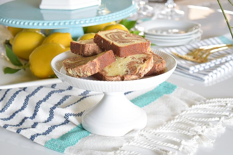 White vase spring summer dishes aqua cake stand forsythia yellow flower bush brunch lemons table scape center piece_-13