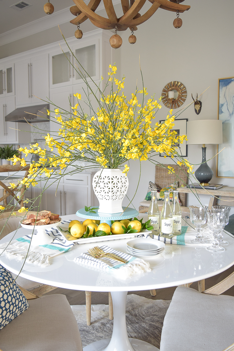 White vase spring summer dishes aqua cake stand forsythia yellow flower bush brunch lemons table scape center piece_-15