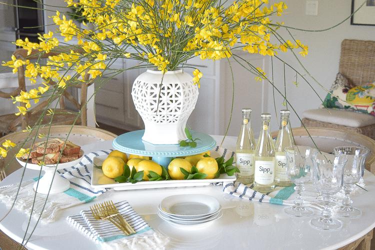 White vase spring summer dishes aqua cake stand forsythia yellow flower bush brunch lemons table scape center piece_-2