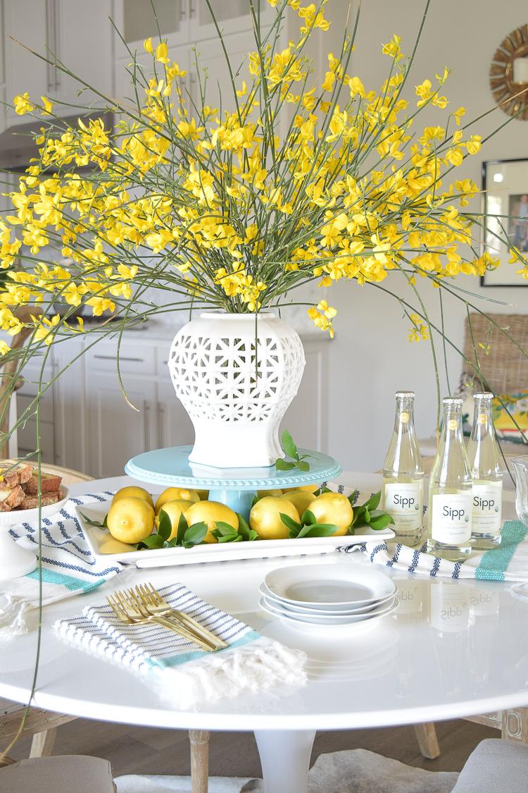 White vase spring summer dishes aqua cake stand forsythia yellow flower bush brunch lemons table scape center piece_-4
