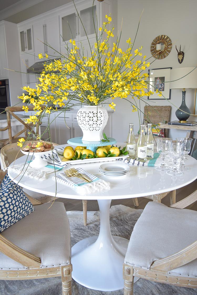White vase spring summer dishes aqua cake stand forsythia yellow flower bush brunch lemons table scape center piece_-5