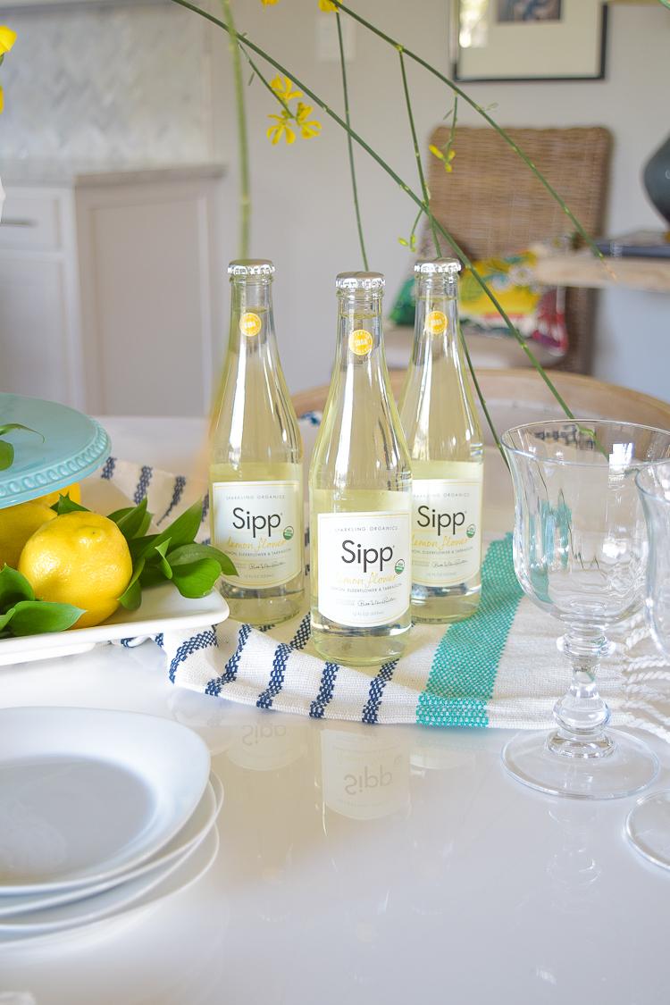 White vase spring summer dishes aqua cake stand forsythia yellow flower bush brunch lemons table scape center piece_-6