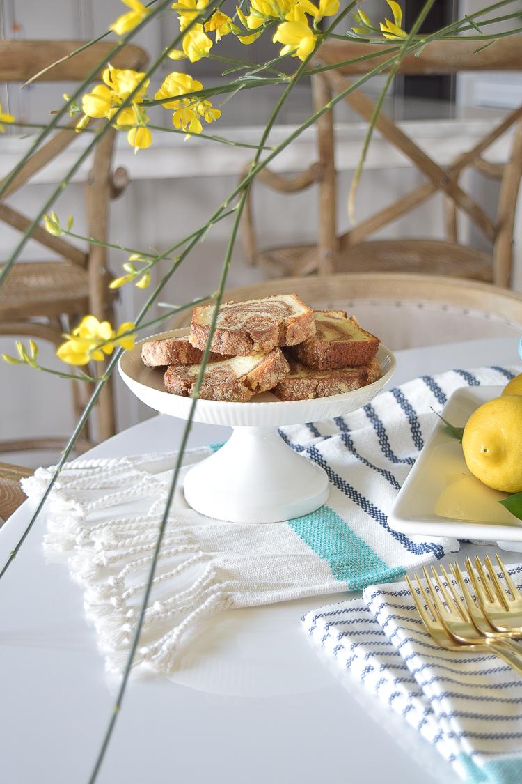 White vase spring summer dishes aqua cake stand forsythia yellow flower bush brunch lemons table scape center piece_-8