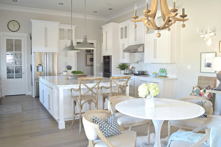 white kitchen carrara marble herringbone backsplash