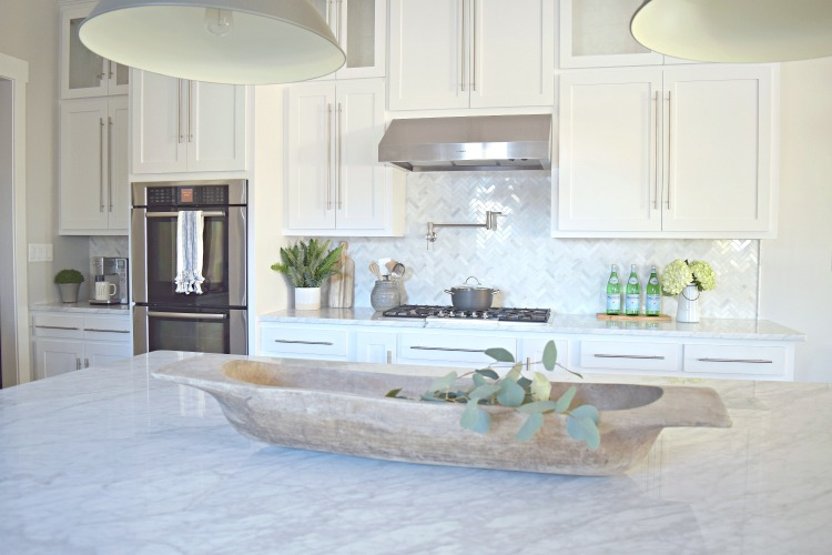 and last but not least two of the things that people always want to know about in our kitchen the most are the carrara marble countertops and the