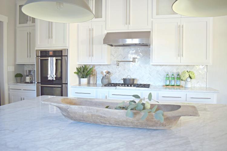 white kitchen dough bowl carrara marble shaker white cabinets