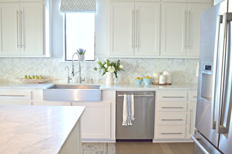 white kitchen farmhouse stainless sink commercial faucet shaker doors carrara marble