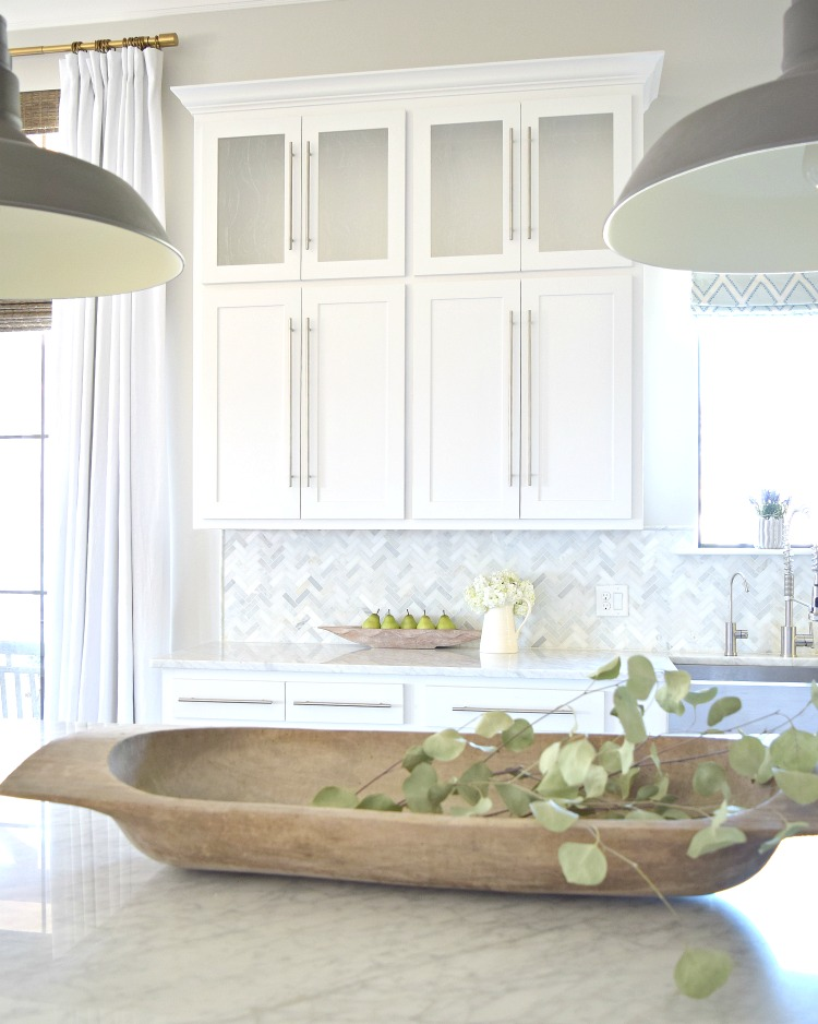 white kitchen herringbone backsplash dough bowl barn pendants carrara countertops