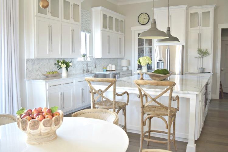white kitchen modern shaker cabinets RH pendants carrara marble