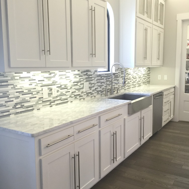 glass and mosaic tile backsplash white kitchen cabinets