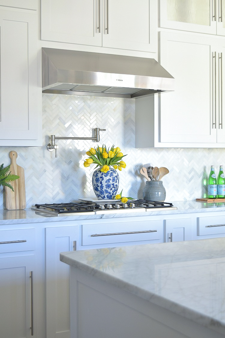 white carrara marble herringbone backsplash8