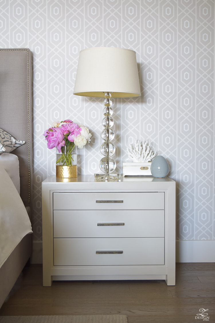 pink and white peonies next to bed geometric thibaut wallpaper_