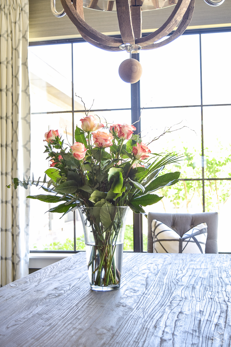 varigated roses rustic dining room kelley wearstler channels pillow in ebony kravet riad curtains in silver_