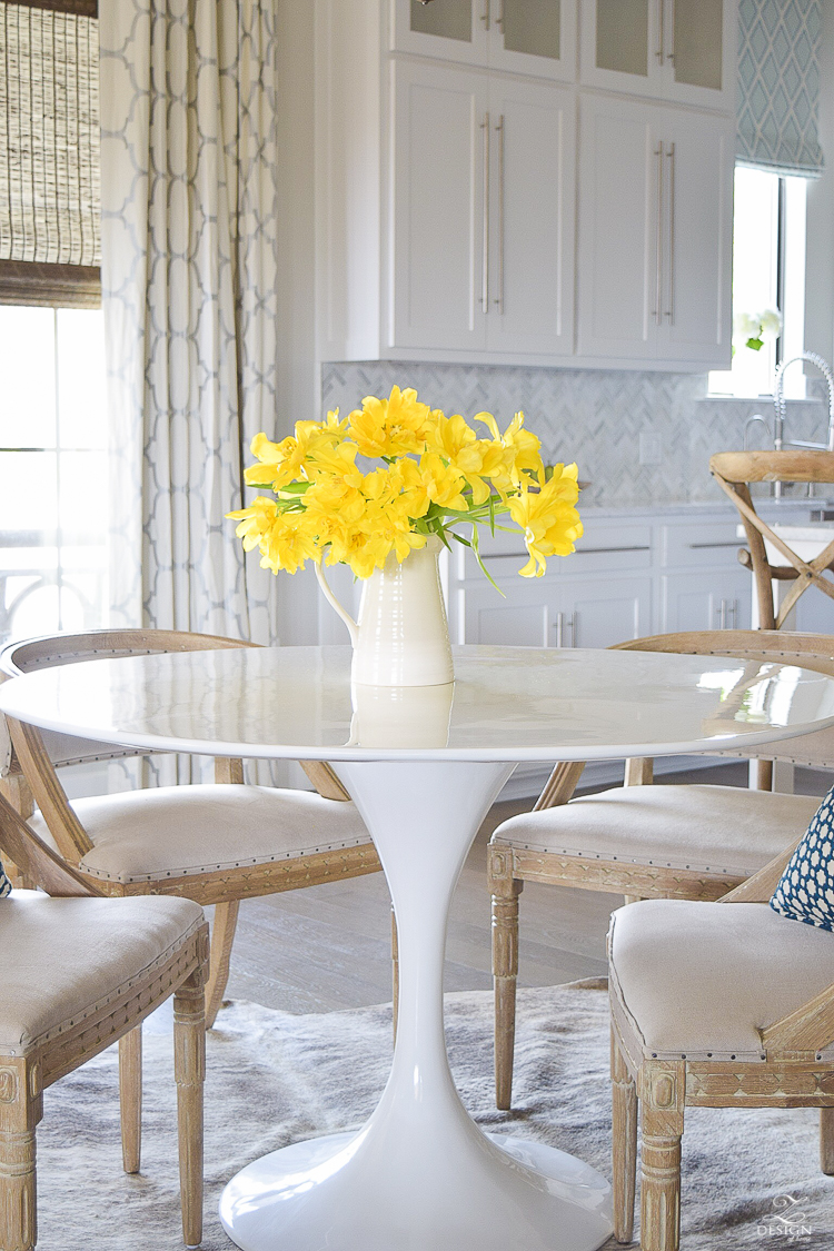 yellow tulips white tulip table white kitchen