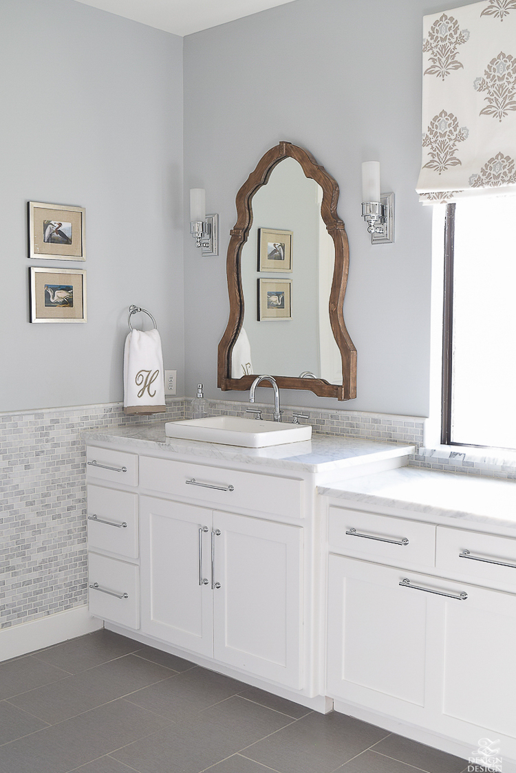 White transitional bathroom wood mirror white cabinets carrara marble-1