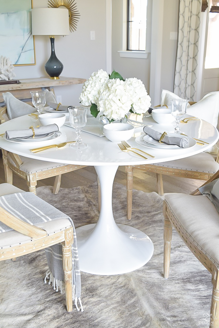 white tulip table with white table setting
