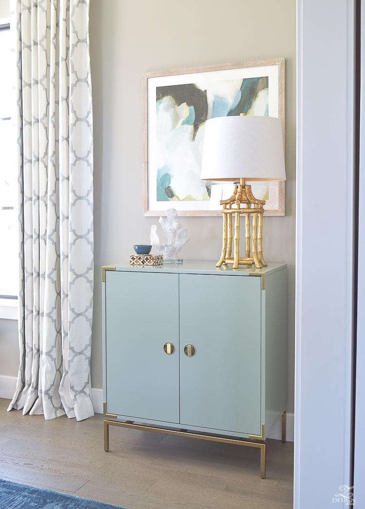transitional modern dining room gold bamboo lamp aqua bar cabinet minted art