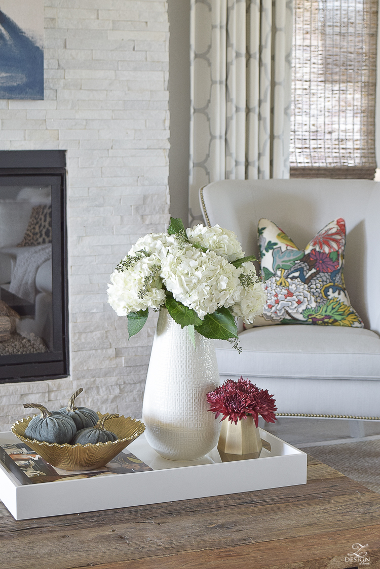 white-transitional-fall-living-room-chiang-mia-dragon-fabric-pillow-leaopard-pillows-fur-stools-kravet-riad-curtains-5