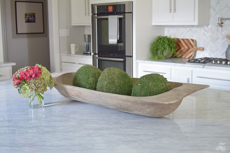 carrara-marble-kitchen-island-bread-bowl-moss-balls-white-farmhouse-kitchen-herringbone-backsplash-