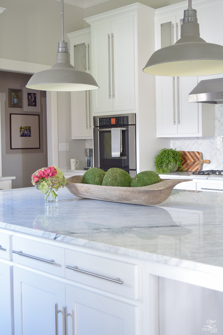 carrara-marble-kitchen-island-bread-bowl-moss-balls-white-farmhouse-kitchen-herringbone-backsplash-2
