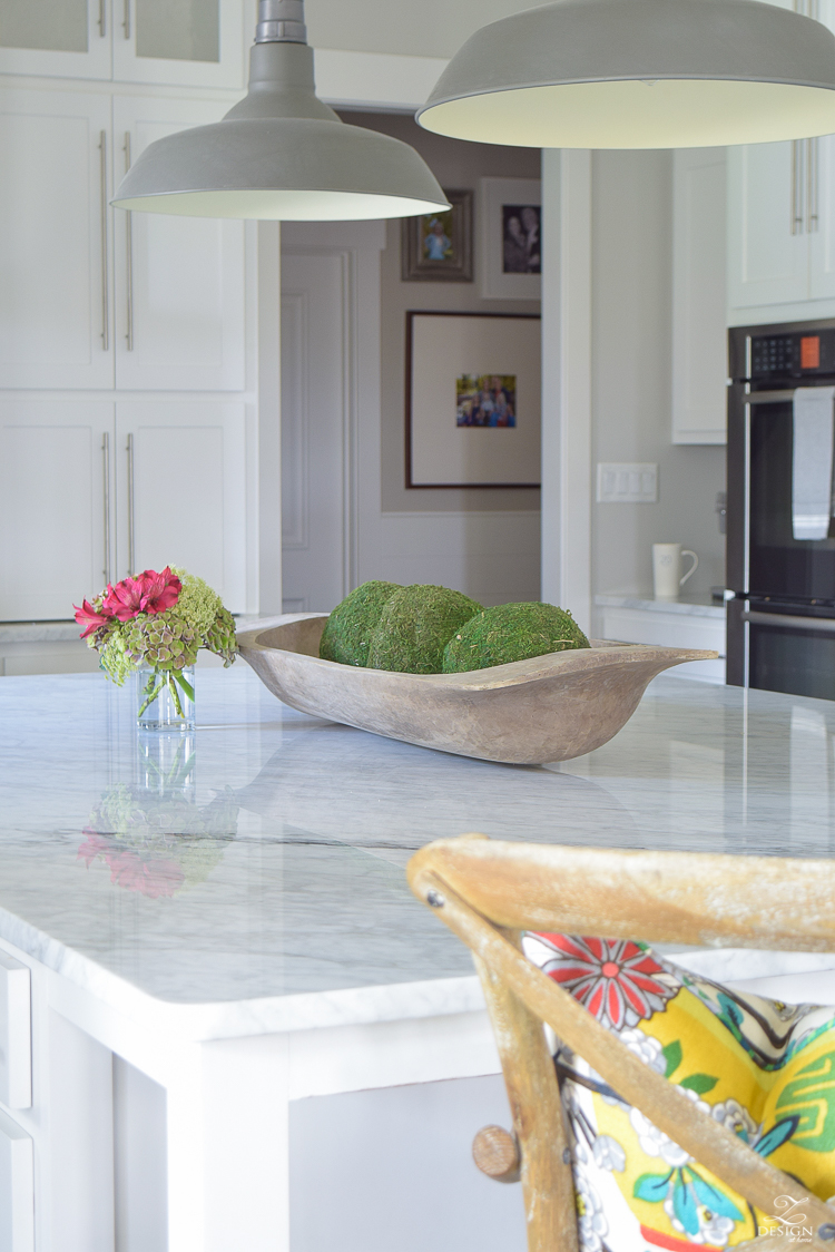 carrara-marble-kitchen-island-bread-bowl-moss-balls-white-farmhouse-kitchen-herringbone-backsplash-3