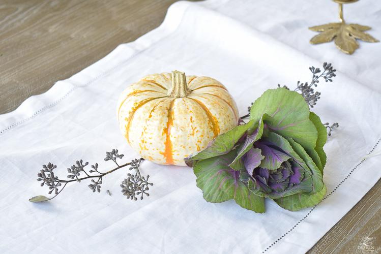easy-fall-pumpkin-centerpiece-white-linen-table-runner-brass-leaf-candlesticks-dining-room-3