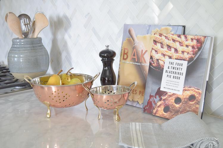 modern-fall-decor-in-the-kitchen-white-carrara-countertops-white-carrara-herringbone-backsplash-brass-pot-1
