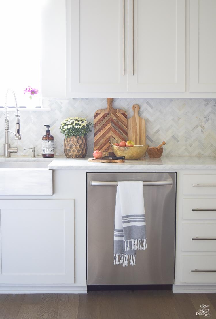 modern-fall-decor-in-the-kitchen-white-carrara-countertops-white-carrara-herringbone-backsplash-brass-pot-3