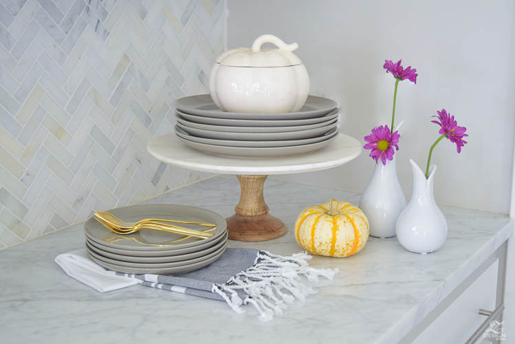 modern-fall-decor-in-the-kitchen-white-carrara-countertops-white-carrara-herringbone-backsplash-brass-pot-white-pumkins-6