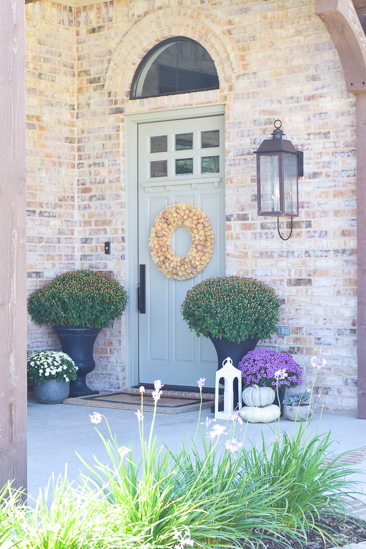 fall-front-porch-fall-flowers-mums-black-planters-mission-style-door-sherwin-williams-exterior-paint-color-mortor-washed-brick-outdoor-bench-monogrammed-coir-door-mat-22