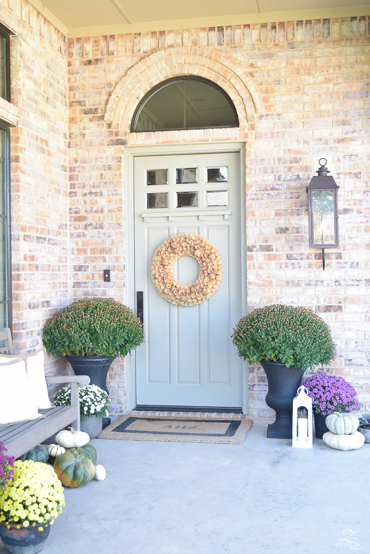 fall-front-porch-fall-flowers-mums-black-planters-mission-style-door-sherwin-williams-exterior-paint-color-mortor-washed-brick-outdoor-bench-monogrammed-coir-door-mat-8