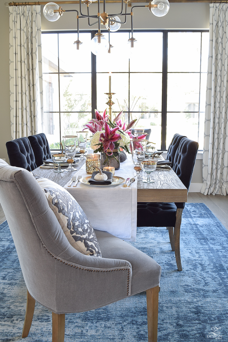 thanksgiving-table-scape-black-velvet-chairs-vintage-inspired-blue-rug-kravet-riad-curtains-gray-washed-dining-table-white-hydrangeas-plum-lillies-1