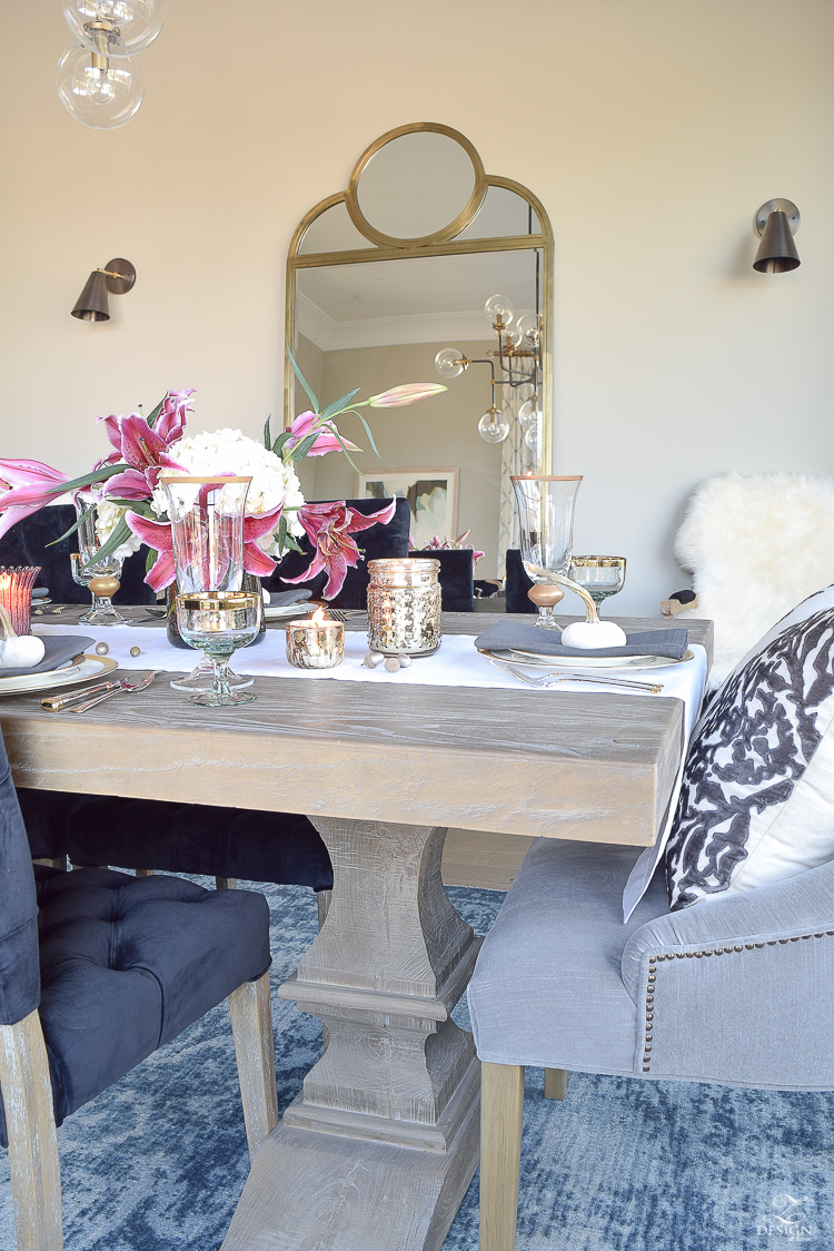 thanksgiving-table-scape-black-velvet-chairs-vintage-inspired-blue-rug-kravet-riad-curtains-gray-washed-dining-table-white-hydrangeas-plum-lillies-17