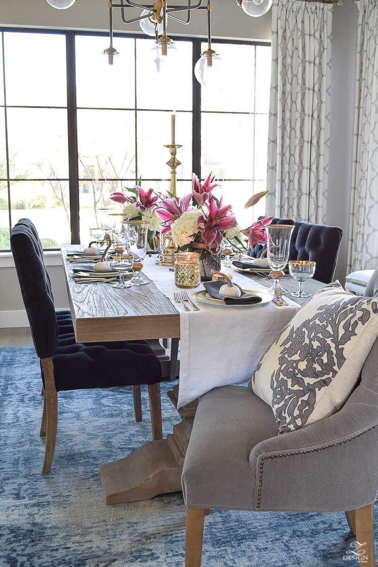 thanksgiving-table-scape-black-velvet-chairs-vintage-inspired-blue-rug-kravet-riad-curtains-gray-washed-dining-table-white-hydrangeas-plum-lillies-2