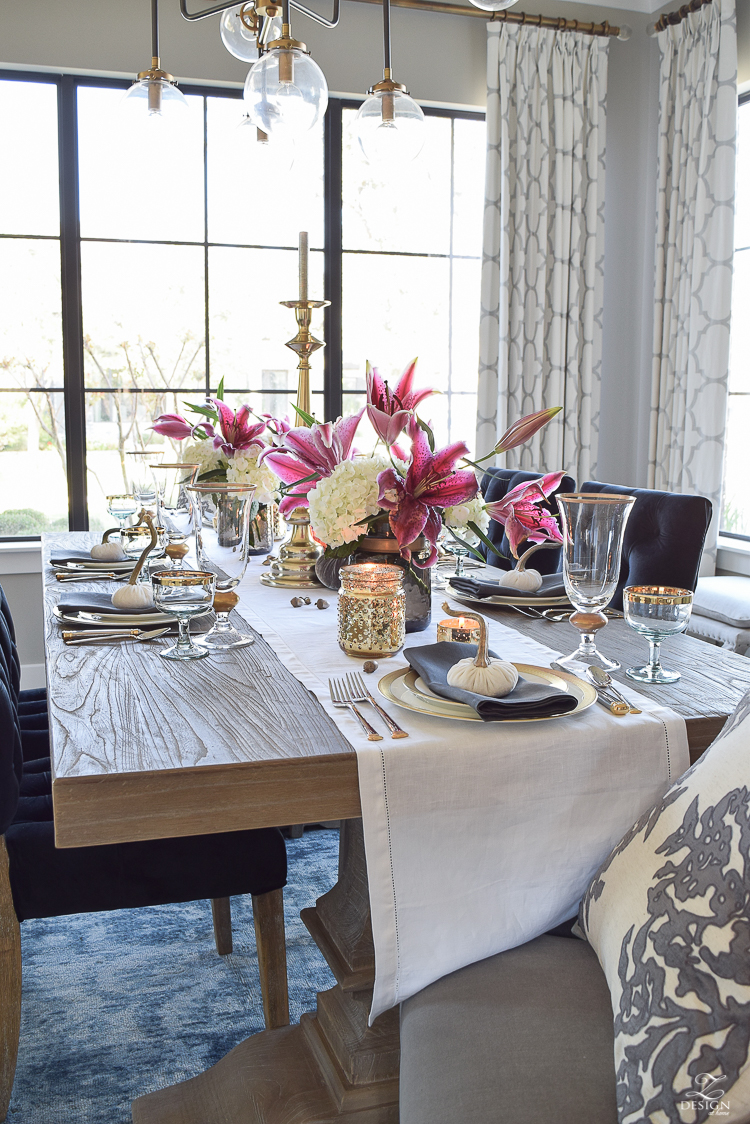 thanksgiving-table-scape-black-velvet-chairs-vintage-inspired-blue-rug-kravet-riad-curtains-gray-washed-dining-table-white-hydrangeas-plum-lillies-4