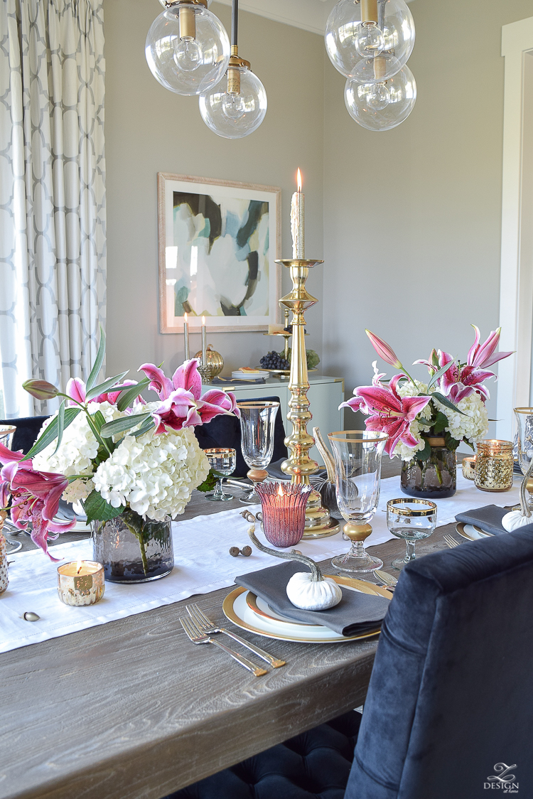 thanksgiving-table-scape-black-velvet-chairs-vintage-inspired-blue-rug-kravet-riad-curtains-gray-washed-dining-table-white-hydrangeas-plum-lillies-5