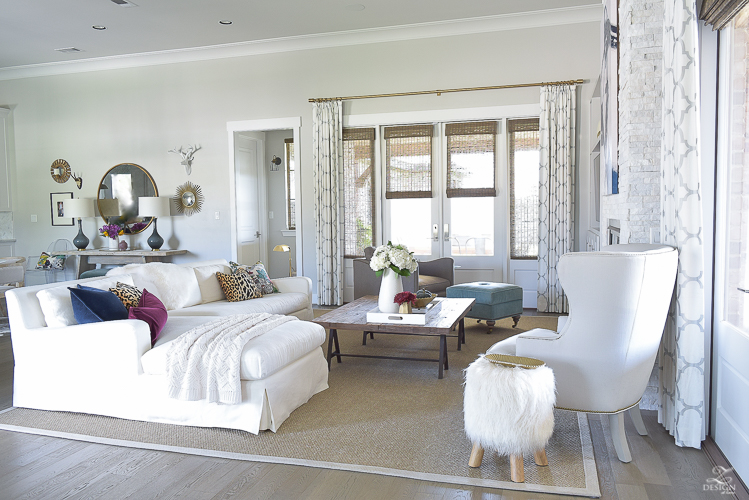 white-transitional-fall-living-room-chiang-mia-dragon-fabric-pillow-leaopard-pillows-fur-stools-kravet-riad-curtains-7