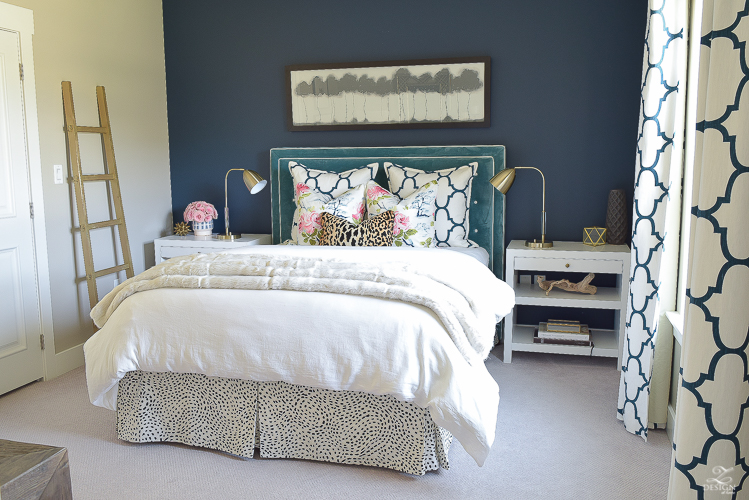 cozy-chic-bedrrom-gold-ladder-navy-wall-gentlemans-gray-white-modern-side-tables-teal-headboard-kravet-riad-navy-fabric-pillows-curtains-gray-carpet-best-gold-spray-paint-2