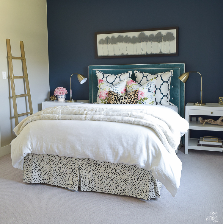 cozy-chic-bedrrom-gold-ladder-navy-wall-gentlemans-gray-white-modern-side-tables-teal-headboard-kravet-riad-navy-fabric-pillows-curtains-gray-carpet-best-gold-spray-paint-3