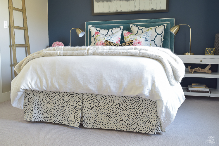 custom-bedskirt-dalmation-fabric-white-faux-fur-throw-benjamin-moore-gentlemans-gray-paint-floral-and-leopard-pillows-white-linen-bedding-brass-lamps-1