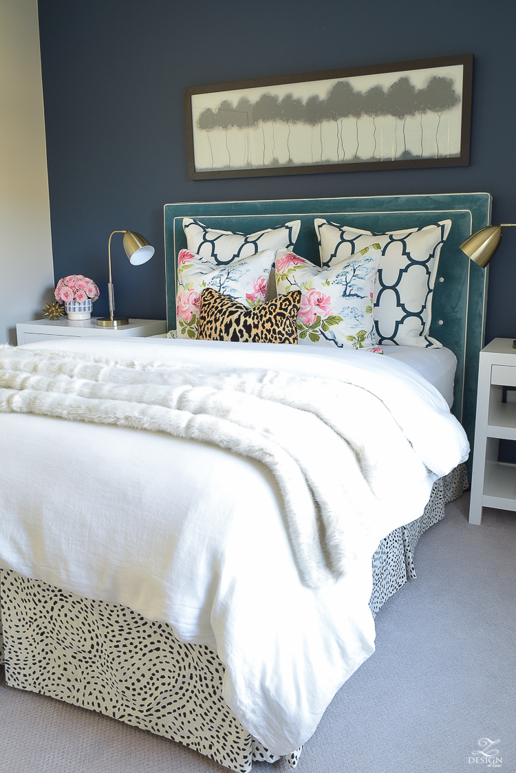 custom-bedskirt-dalmation-fabric-white-faux-fur-throw-benjamin-moore-gentlemans-gray-paint-floral-and-leopard-pillows-white-linen-bedding-brass-lamps-2