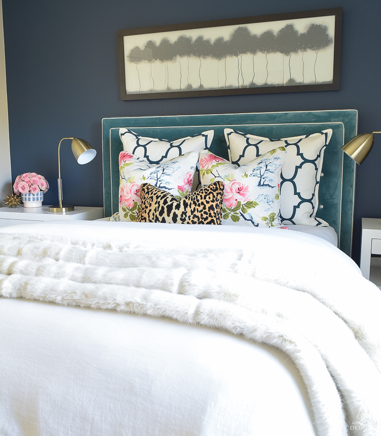 custom-bedskirt-dalmation-fabric-white-faux-fur-throw-benjamin-moore-gentlemans-gray-paint-floral-and-leopard-pillows-white-linen-bedding-brass-lamps-4